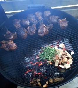Grilling and smoking lamb chops with rosemary and hickory smoke